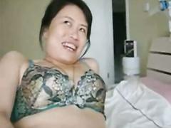 Asiatische Frau, die Sex auf Video